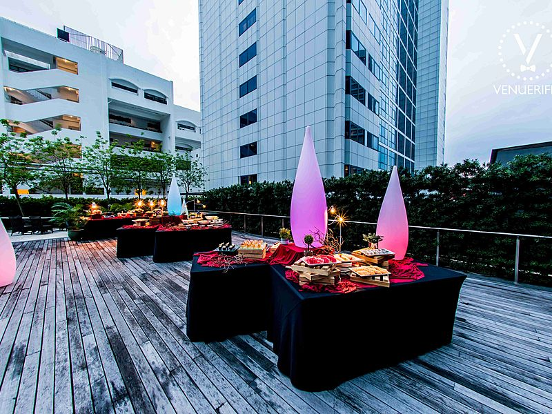 rooftop venue with pool, finger food, and canapes
