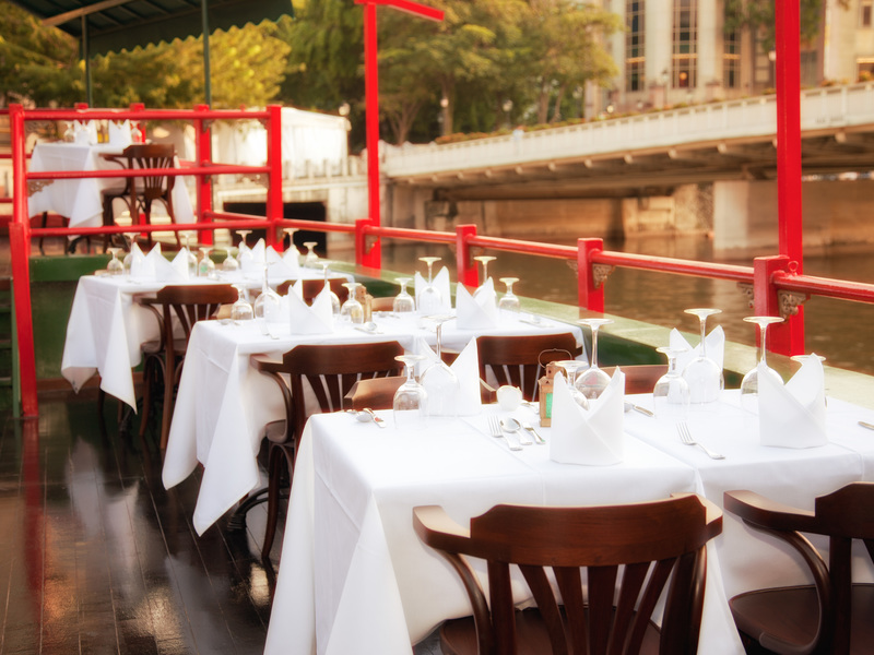Dining in a boat to impress your clients in Singapore