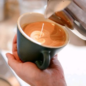 best-coffee-places-venuerific-blog-the-populus-cafe-and-coffee-co-pouring-milk