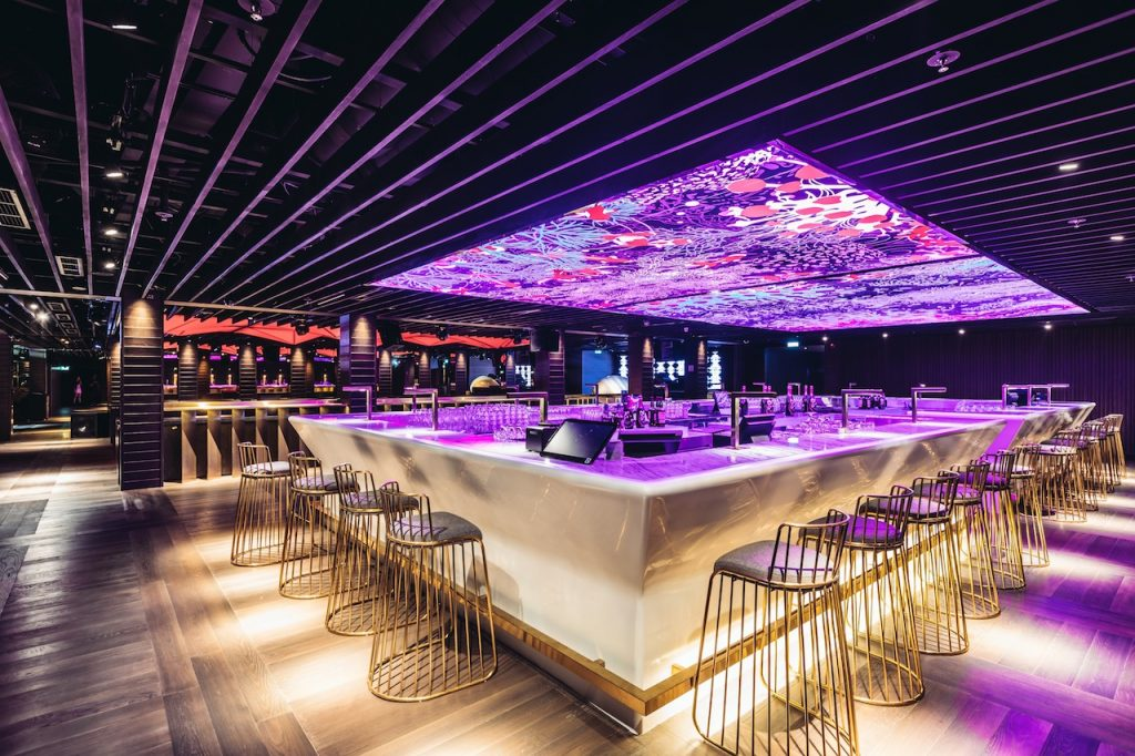 elegant bar and party area with purple ceiling