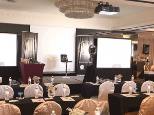 Small function room corporate event with stage