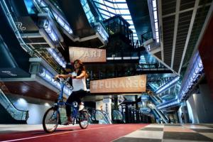 girl is cycling inside funan mall