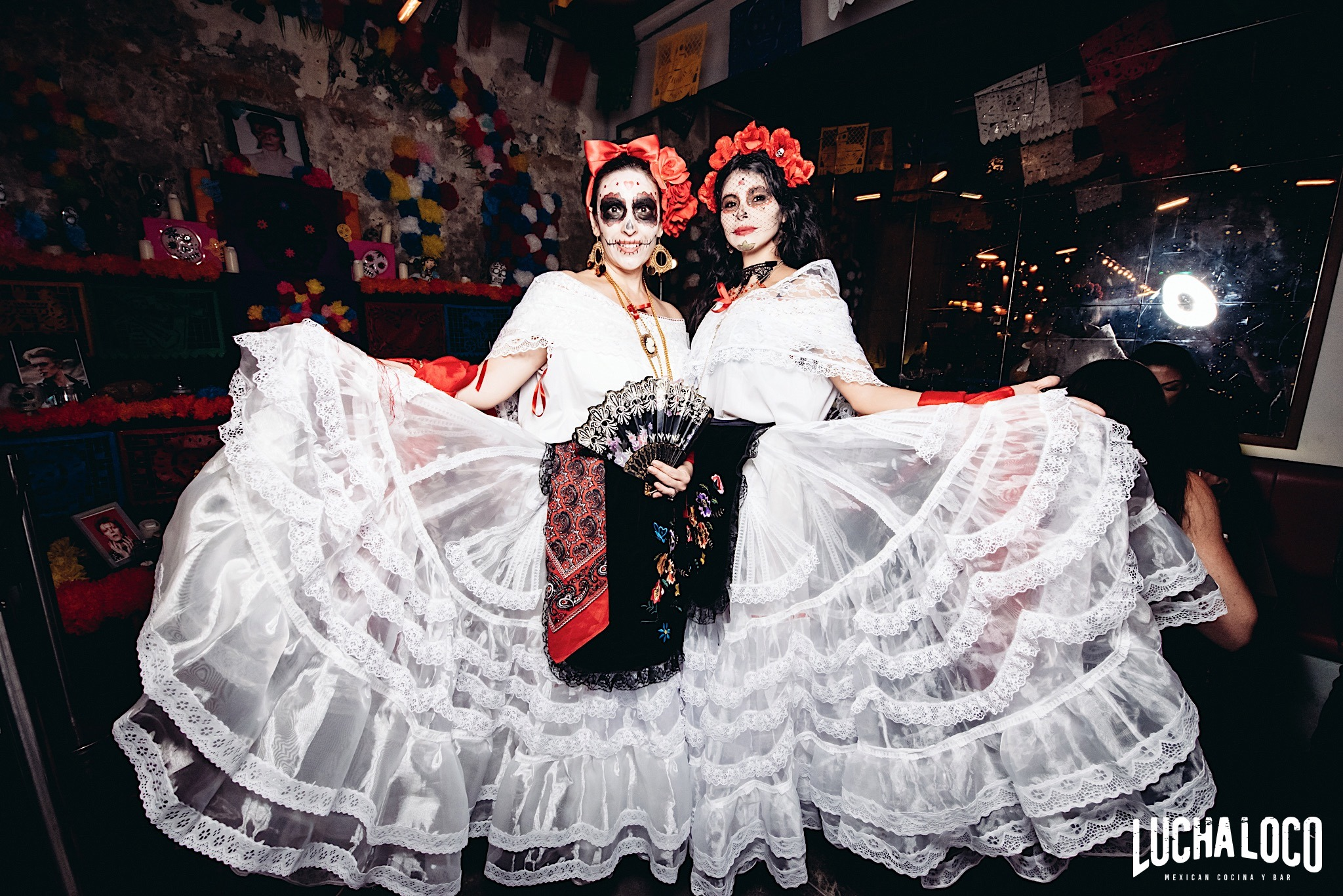 women with halloween costume mexican bar singapore