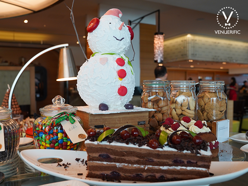 christmas dessert station with snowman