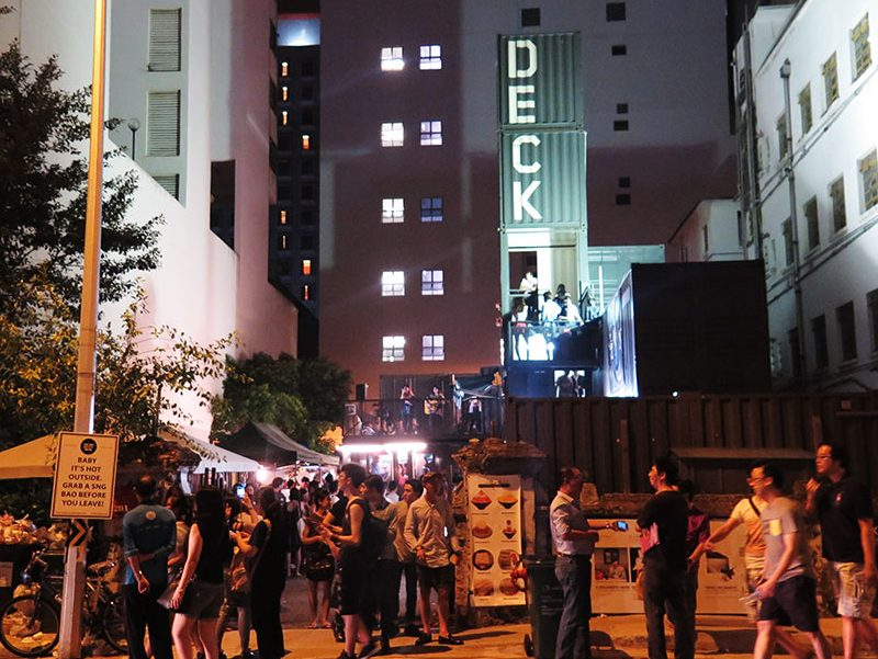 crowded night at a container gallery